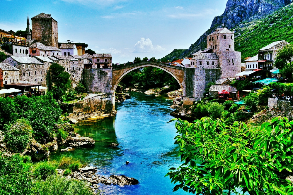 Stari Most is a bridge in Mostar, Bosnia and Herzegovina. It was destroyed during the Bosnian War in the 1990s. Its reconstruction in 2004 symbolizes the rebuilding of communities across the Balkans.
