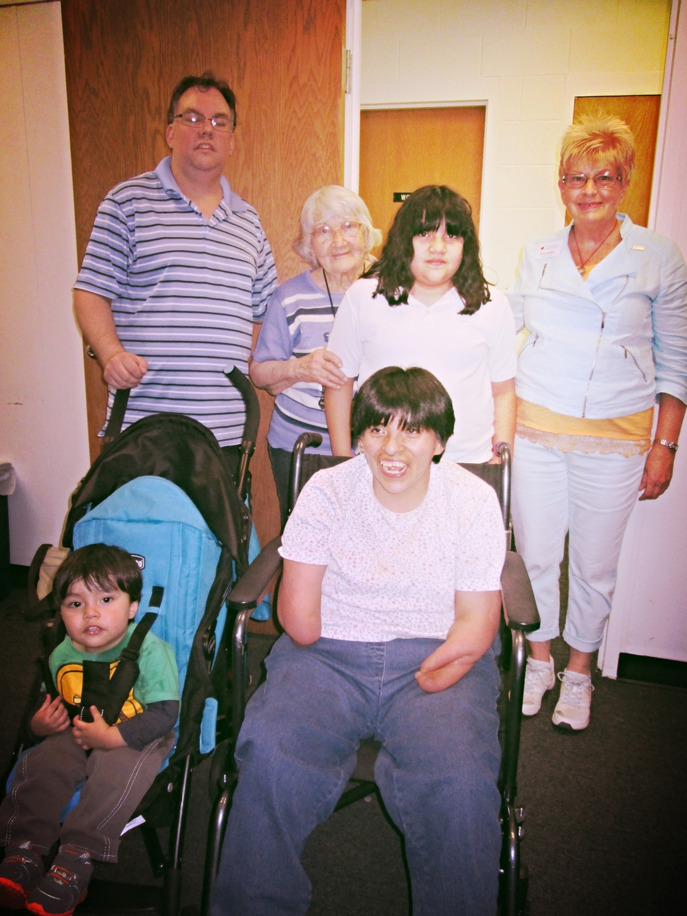 Mechi and her family along with Red Cross caseworker, Fran Dutton
