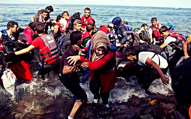 Refugees arrive on a dinghy after crossing from Turkey to Lesbos island, Greece. Photo: AP