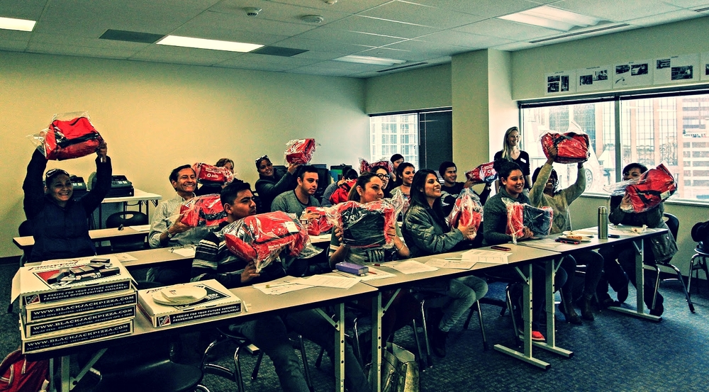Following Red Cross Disaster Preparedness and Restoring Family Links training, students show off the Red Cross emergency kits they received at the end of the training. Photo credit: Styliani (Stellina) Giannitsi
