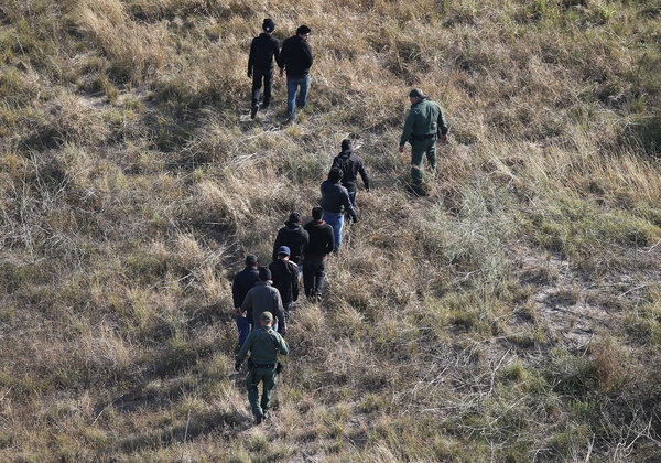 United States Border Patrol agents escorted immigrants last month after capturing them in La Grulla, Tex. Photo credit: John Moore, Getty Images