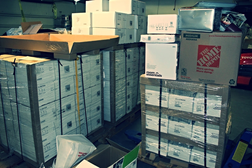 Enough supplies for 124 refugee welcome kits stacked and ready at the Red Cross. Supplies include pots, pans, silverware, dishes, cooking utensils, mattresses and blankets.