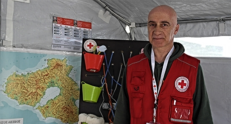 Amar Wakim chose to travel all the way from northern Greece to Lesvos to work as a Restoring Family Links volunteer by the shores. Being Syrian himself he has easily been able to communicate with migrants. Photo credit: Caroline Haga, IFRC