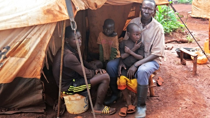 Kigoma region, Tanzania. Ntirabampa and his children sitting outside their tent at Nyarugusu refugee camp. Photo Credit: Lynette Kamau, ICRC