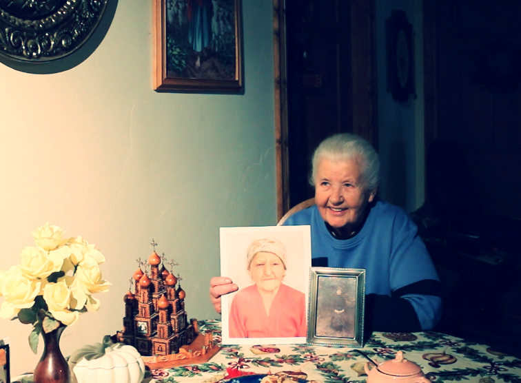 Marta Kruk Lysnewycz in her home with pictures of her sister, Vassia, and their mother.