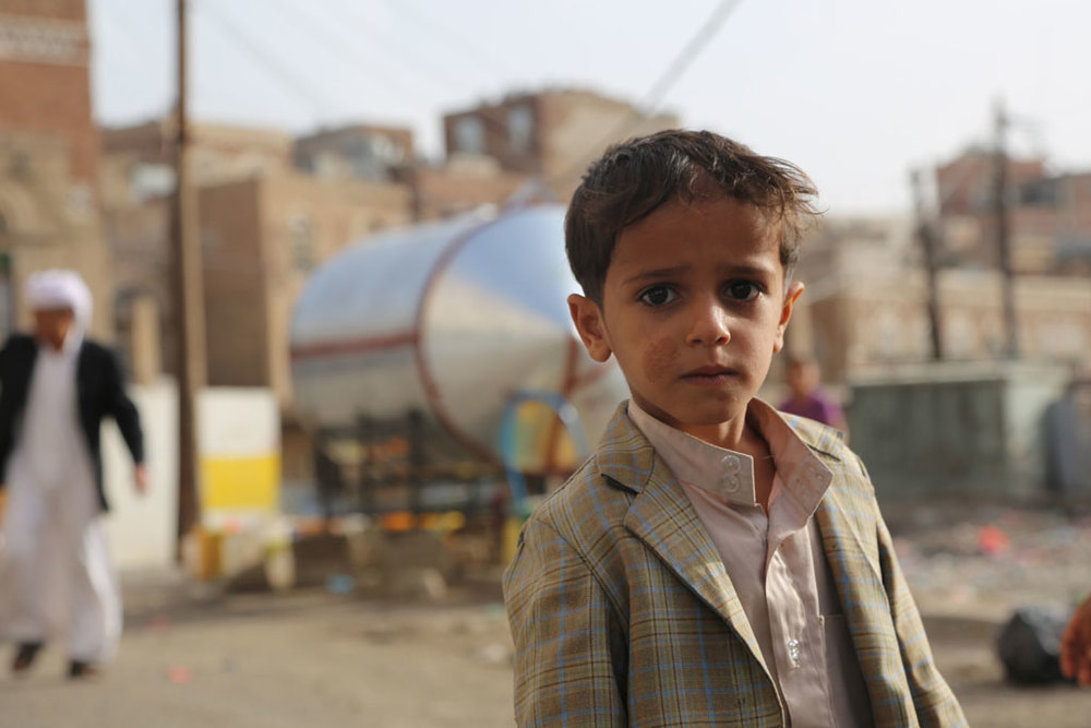 A six-year-old boy gets water from this water point in Musaik, a neighbourhood of Sana'a. Photo: OCHA/Charlotte Cans