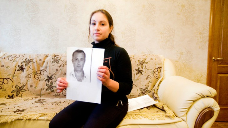 Gorlovka, Donetsk region, eastern Ukraine. Jelena holds a sheet from the ICRC tracing request that show photos of her missing father. Photo credit:Pieter-Jan De Pue