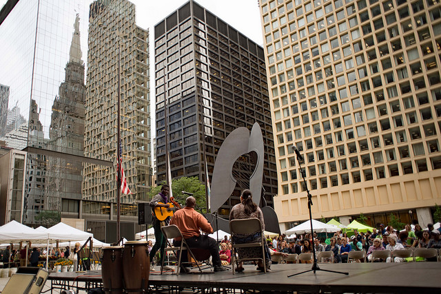 Abraham Mellish plays before the crowd at Daley Plaza celebrating World Refugee Day in Chicago. Photo Credit: American Red Cross - Chicago and Northern Illinois Region Chapter.