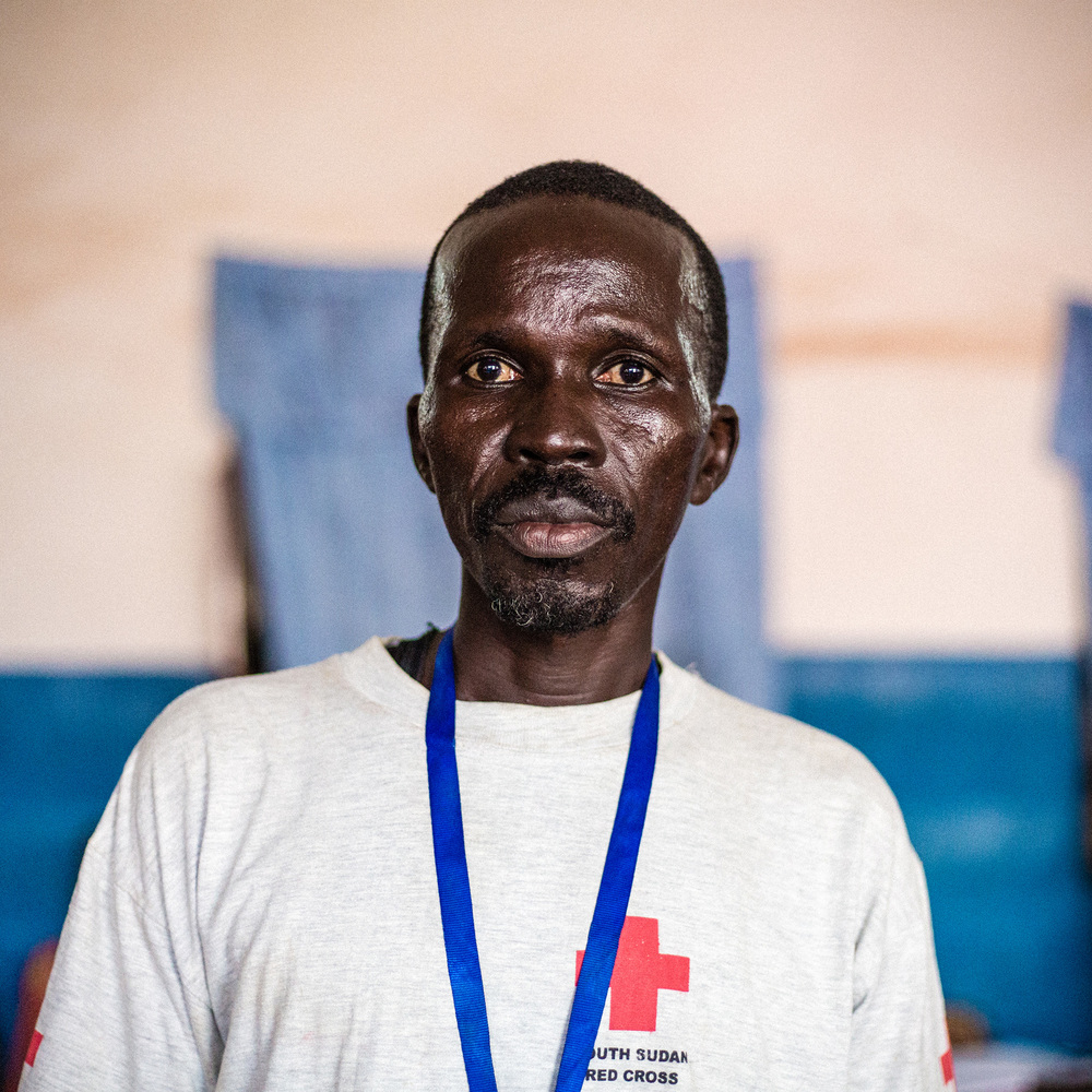 Amin is providing first aid at the Red Cross clinic.   I'm a tailor and I usually work at the market. It is now closed, so I can't work. So many people are here. I sometimes worry we don't have the capacity to help everybody.