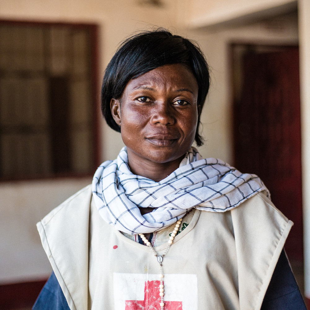 "Christina is raising awareness on how to maintain hygiene in difficult conditions.   ""When the violence started I came to the Red Cross compound with my little daughter. We still can't return home. We need safety. You can even survive without food, but the most important thing is safety."""