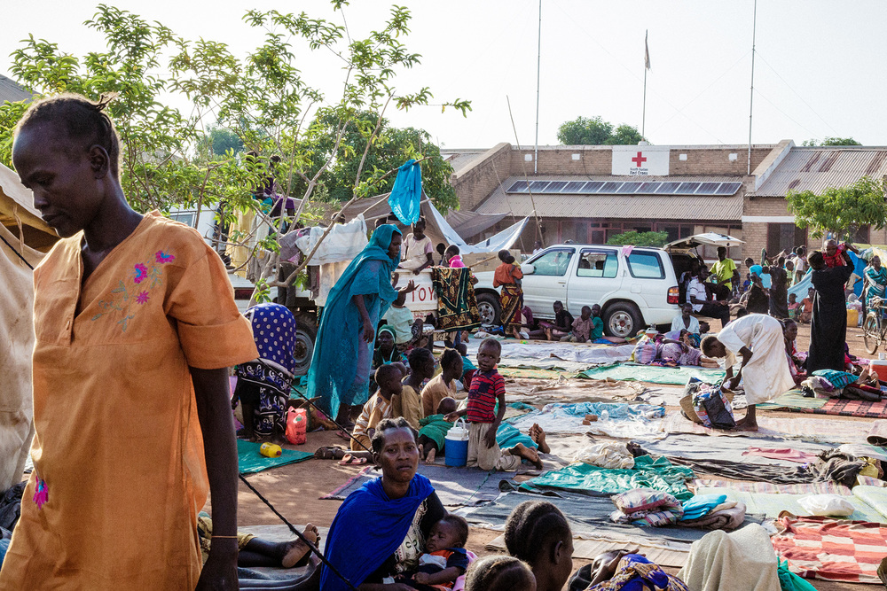 Wau, South Sudan.   Some 5,000 displaced people came to the South Sudan Red Cross compound following the armed clashes. In the first hours they received food and some basic household items.