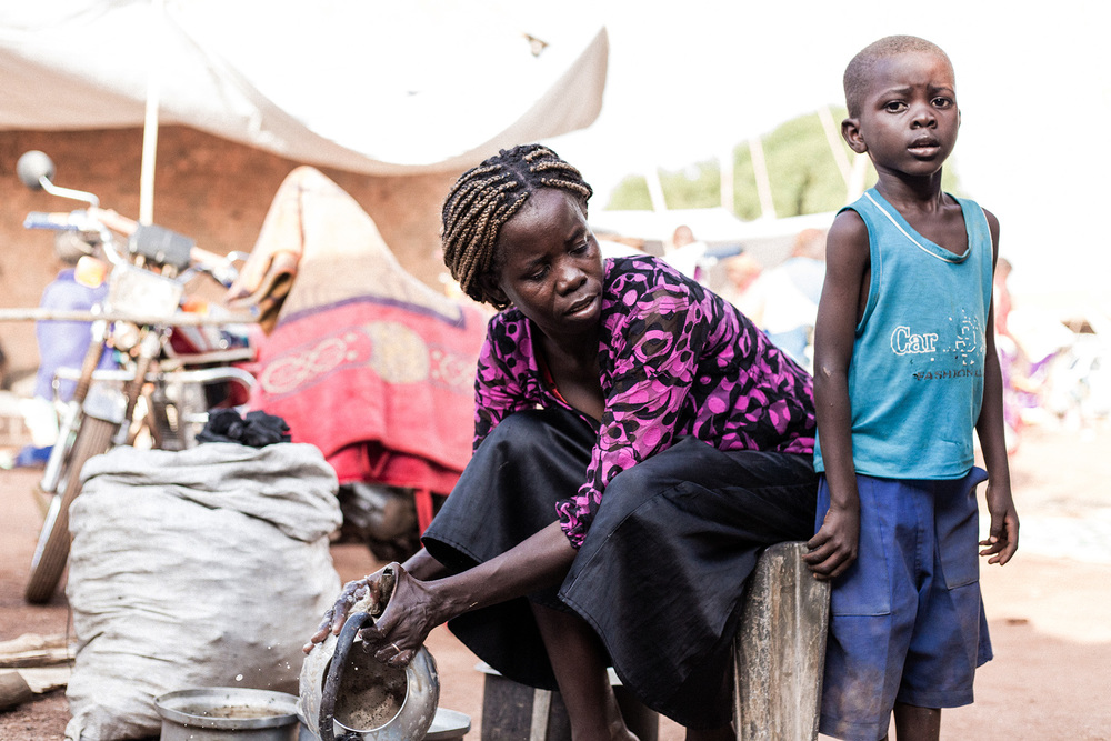 Wau, South Sudan.   A mother and son at the south Sudan Red Cross compound, where some 5,000 people fled following the armed clashes. In the first hours they received food and some basic household items.