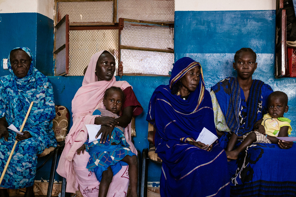 Wau, South Sudan.   Women waiting to receive medical care at the clinic in the South Sudan Red Cross compound.