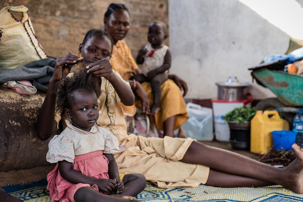 Wau, South Sudan.   A mother and daughter at the south Sudan Red Cross compound, where some 5,000 people fled following the armed clashes. In the first hours they received food and some basic household items.