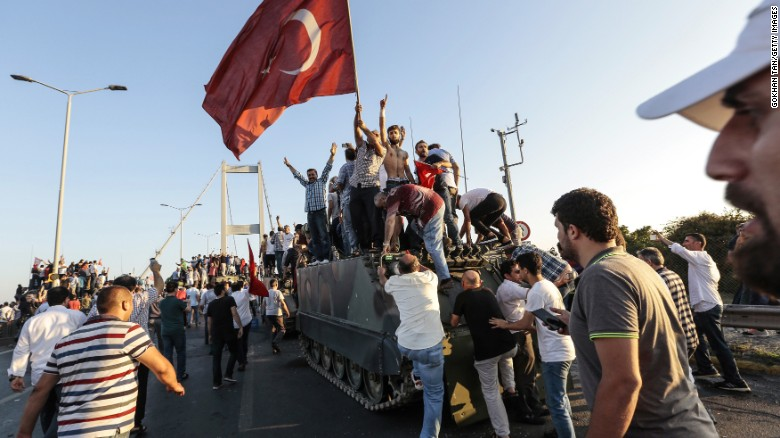 Erdogan supporters capture a Turkish army vehicle after soldiers surrendered Saturday. Photo credit: CNN