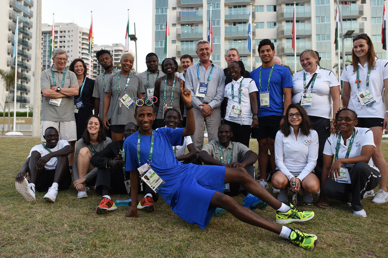 Members of the Refugee Olympic Team have their picture taken with United Nations High Commissioner for Refugees Filippo Grandi and UNHCR staff inside the Olympic Village. For the first time in Olympic history, the International Olympic Committee has created a team comprised of refugees competing as the Refugee Olympic Team. Photo Credit: Benjamin Loyseau/UNHCR.