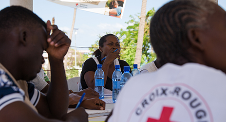 Volunteers of Haitian Red Cross participate in training for cholera prevention campaign. Photo Credit: Maria Santto/Finnish Red Cross