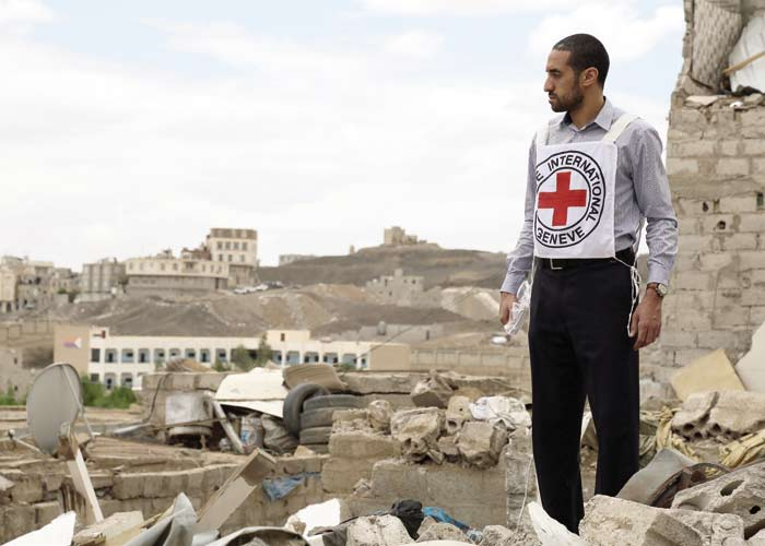 Delegate of ICRC among rubble post air strike in Sanaa. Photo Credit: Samar Kadi