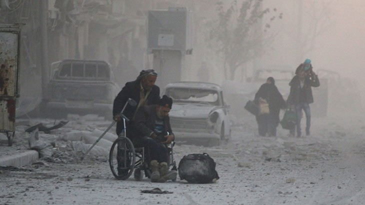 A man in a wheelchair fleeing the violence in eastern Aleppo. Photo Credit: REUTERS/Abdalrhman Ismail