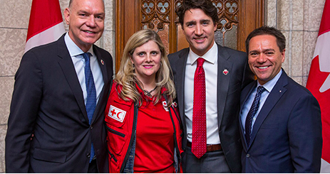 Canadian Prime Minister Justin Trudeau with members of the Canadian Red Cross, including Dr Lynda Redwood-Campbell, in May 2016.