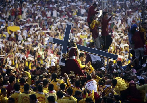Filipino Devotees carrying image of Black Nazarene. Photo Credit: AP FILE