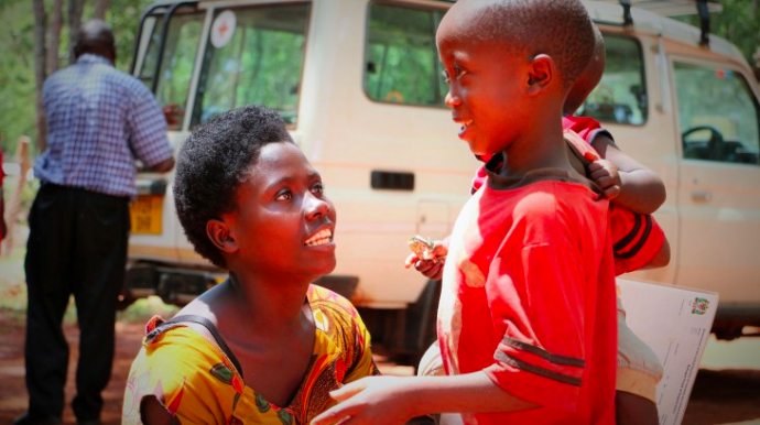 Genveva is reunited with her seven-year-old son after conflict in Burundi forced her to flee to Tanzania. CC BY-NC-ND / ICRC / Mike Mina