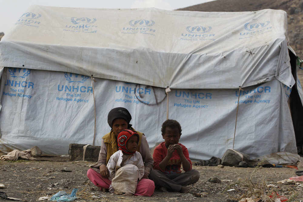 12 year old girl in Yemen keeps watch over her younger siblings. Photo credit: UNHCR/Mohammed Hamoud