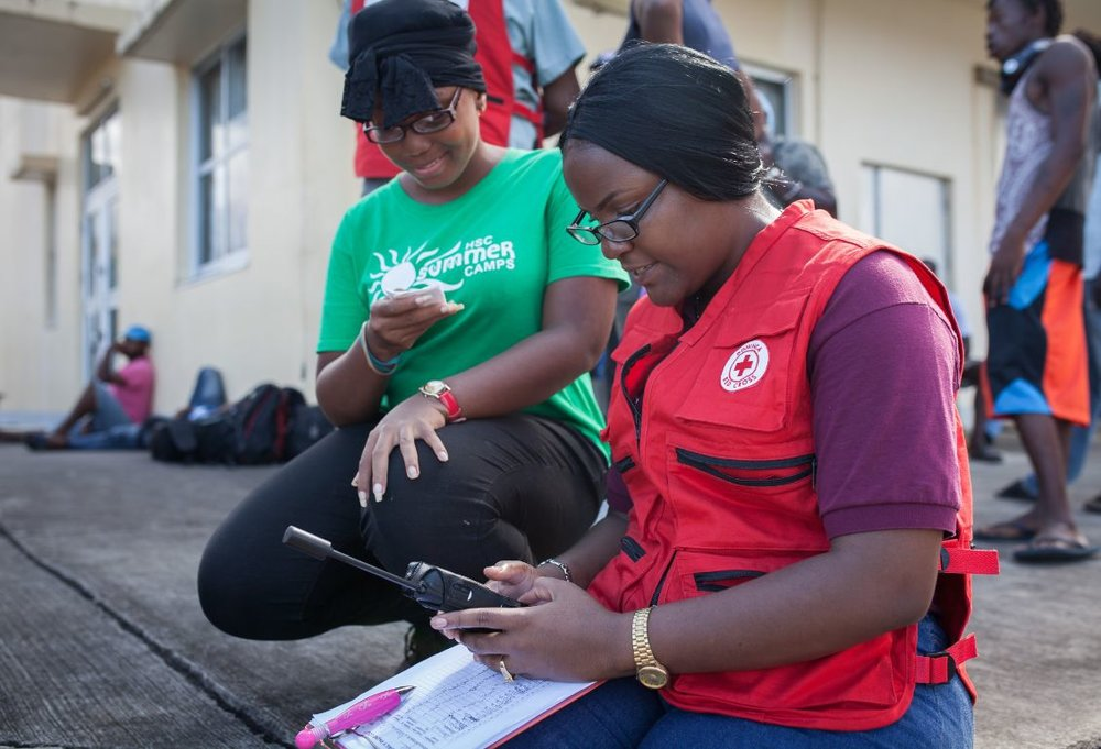 The Red Cross is helping hurricane survivors on the island of Dominica to reconnect with loved ones through satellite phones and written messages.