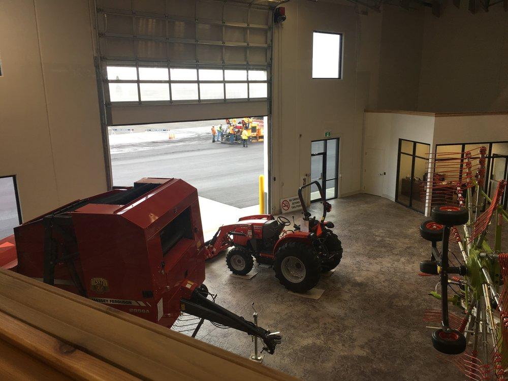 2017-06-05 (1) Horseshoe finishing the second lift of asphalt outside East showroom door.JPG