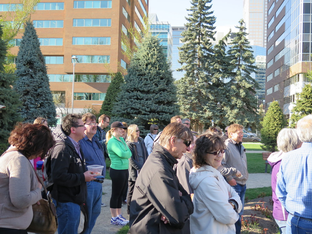 "Central Memorial Park: the crowd listens to the Calgary poems of Maxwell Bates and Lisa L. Moore, a Calgary native now living and teaching in Austin TX. One of Moore's Calgary poems is called "" Cold Garden ,"" the Old Norse words for Calgary Bay on Colonel James Macleod's ancestral homeland on the Isle of Mull."