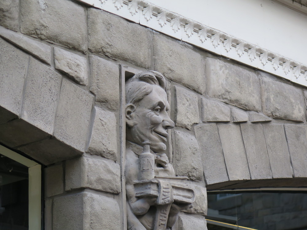 One of the Calgary  Herald  gargoyles on the historic Alberta Hotel building: a medieval feature with a contemporary twist. Figures depict newspaper staff members, including the stenographer and the cleaning lady.