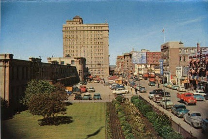 Looking west to the Palliser Hotel, also known as the Castle by the Tracks, in what looks to be the 1950s. The old Calgary railway station is in the left foreground and Ninth Avenue is on the right. (Photo:  Calgary Public Library )