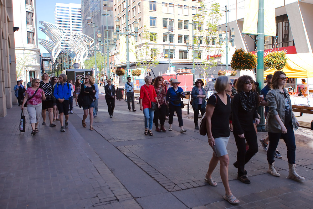 Stephen Avenue: A Jane's Walk parade down what was the 1912 Stampede parade route. Novelist Nancy Huston (Plainsong) and poet Yvonne Trainer (Tom Three Persons) capture two different aspects of Guy Weadick's first Stampede. (Photo: Reg Tiangha)