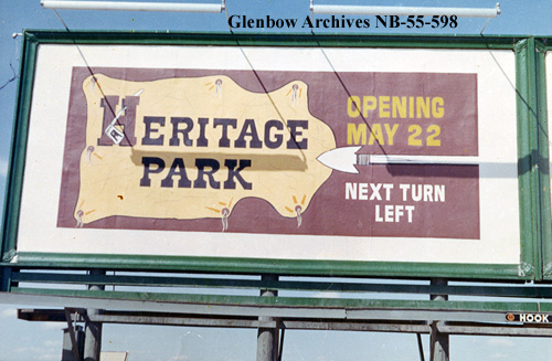 Heritage Park billboard, 1966. On the southeast edge of Glenmore Reservoir, Calgary's historical theme park is part of the legacy of Calgary oilman and philanthropist, Eric Harvie. The park opened on July 1, 1964 with two dozen historical buildings and a vintage train. (Photo: Glenbow Archives)