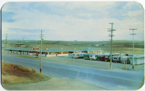 """Blue-Bird Motel and Trailer Court, 3912 MacLeod Trail, circa 1955. """"Modern, comfortable and well furnished cottages, for summer and winter comfort. Close to the City Centre on Highway No. 2. Calgary's Finest Trailer Court. Pleasant quiet and courteously managed. Your Hosts: Mr. and Mrs. Ed. Pahl."""" (Photo: Calgary Public Library Postcards from the Past)"""