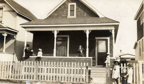Calgary's Boyer family on the porch of their home at 819 - 5th Ave NW. As the crow flies, this house is not far from the peninsula in what Catherine Simmons calls one of her Calgary porch stories. The Boyers' house was scheduled for demolition in 2013. (Photo:  Calgary Public Library Postcards from the Past )