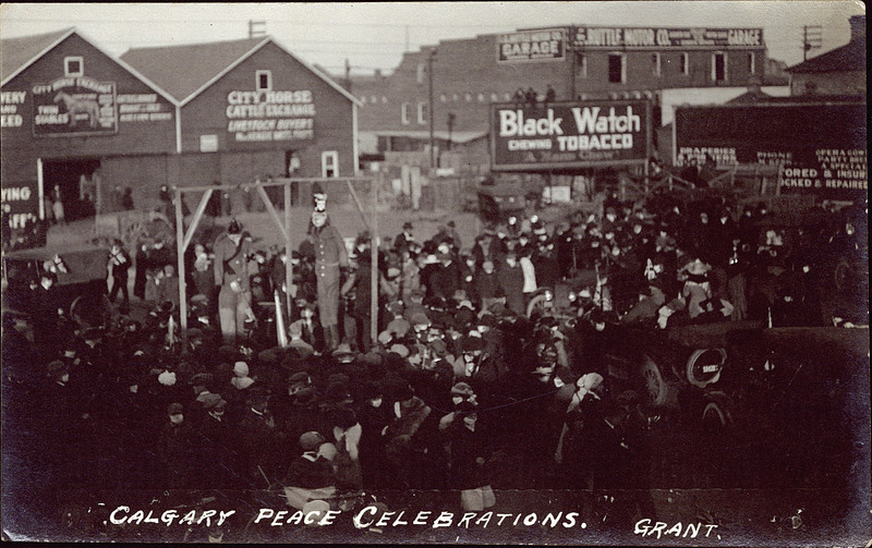 "Armistice Day in Calgary, November 11, 1918. The crowd gathers in front of City Hall to celebrate the end of the war. Look closely: only a few citizens are following the ""mask order"" issued to stop the spread of the Spanish flu. Later in the evening, the hanging effigies of the German Kaiser and Crown Prince were burned in bonfires on the North Hill and overlooking Elbow Park. (Photo: Peel's Prairie Provinces)"