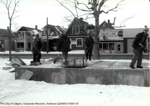 Workers (circa 1960s) construct an electric vault on 17th Avenue in front of present-day Mount Royal Village. This spring, the City begins a controversial year-long rejuvenation project for the landmark avenue. (Photo: City of Calgary Archives)