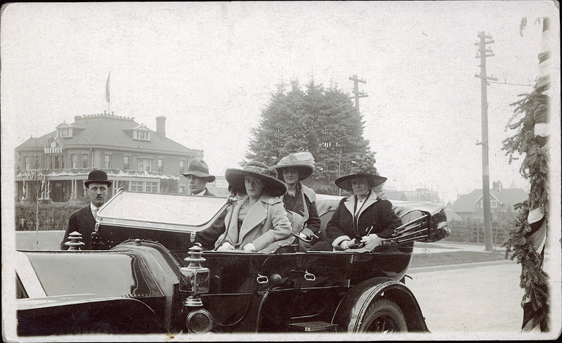 Passengers in an automobile, Calgary, Alberta, circa 1915 -- perhaps off to the Mariaggi. The Stephen Ave restaurant was a landmark in frontier Calgary, and briefly home to The Ranchmen's Club. In the background: William Roper Hull's mansion, Langmore, on 6th Street & 13th Ave West.  (Photo: University of Alberta Peel's Prairie Provinces)