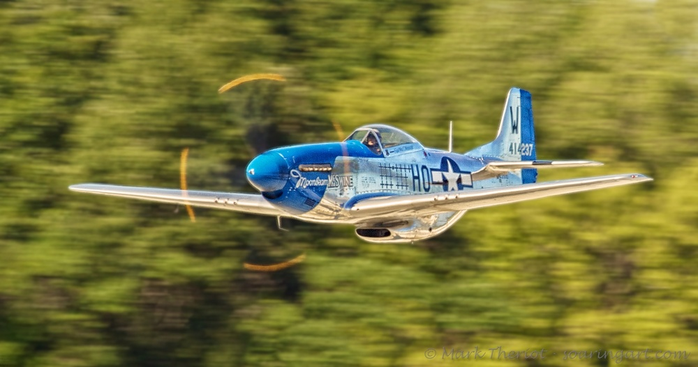 P51D Mustang making a low and fast show pass.
