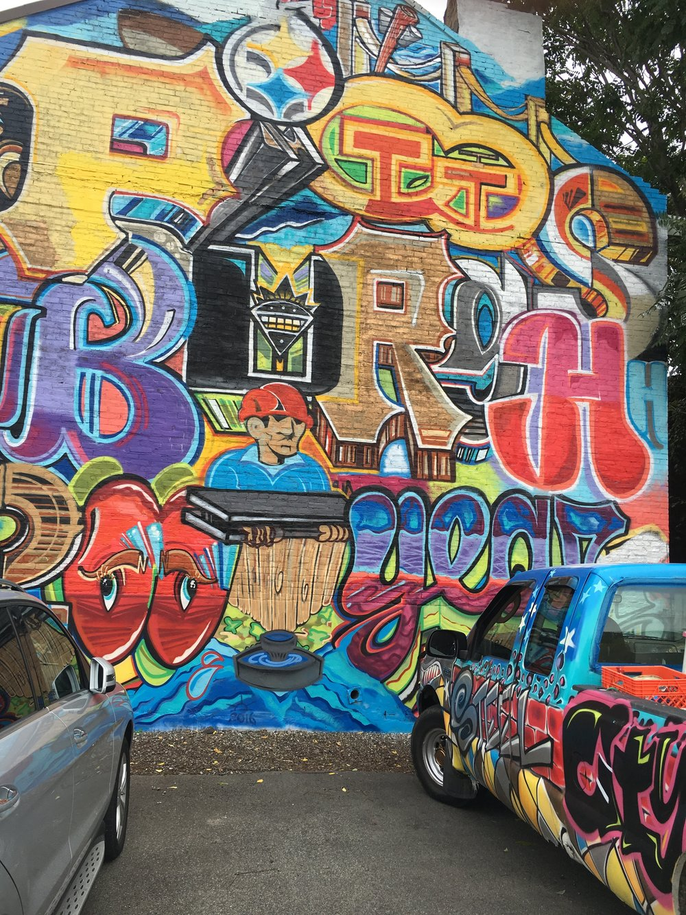 "Uptown mural matches ""Artoberfest car""-Steel City Street Art Festival"