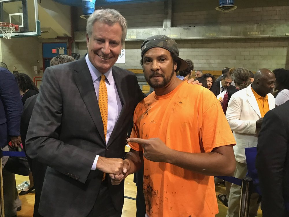New York City Mayor Bill De Blasio and Artist Kyle Holbrook at Police Athletic League Headquarter in Harlem, Kyle has been partnering with P.A.L. at event all over NYC during the spring, summer and fall in 2017, each mural was painted with NYPD officers, community member and youth and will be permanently placed in Armories and Community Center throughout NYC and a permanent reminders of the beauty that can be made when we work together.