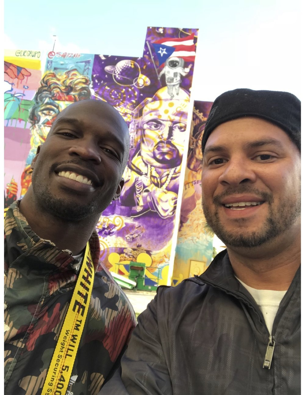 "Chad ""Ochocinco"" Johnson and Kyle Holbrook at the Puerto Rico Hope mural, Ochocinco was artistically shooting photography of the mural when KYLE SAW HIM, THATS WHAT ""ARTWORLD"" IS ALL ABOUT!!!"