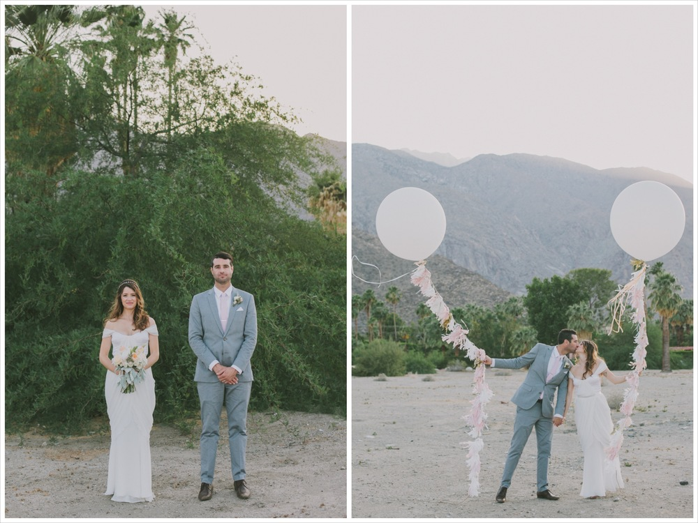 bride and groom posing with oversized balloon props