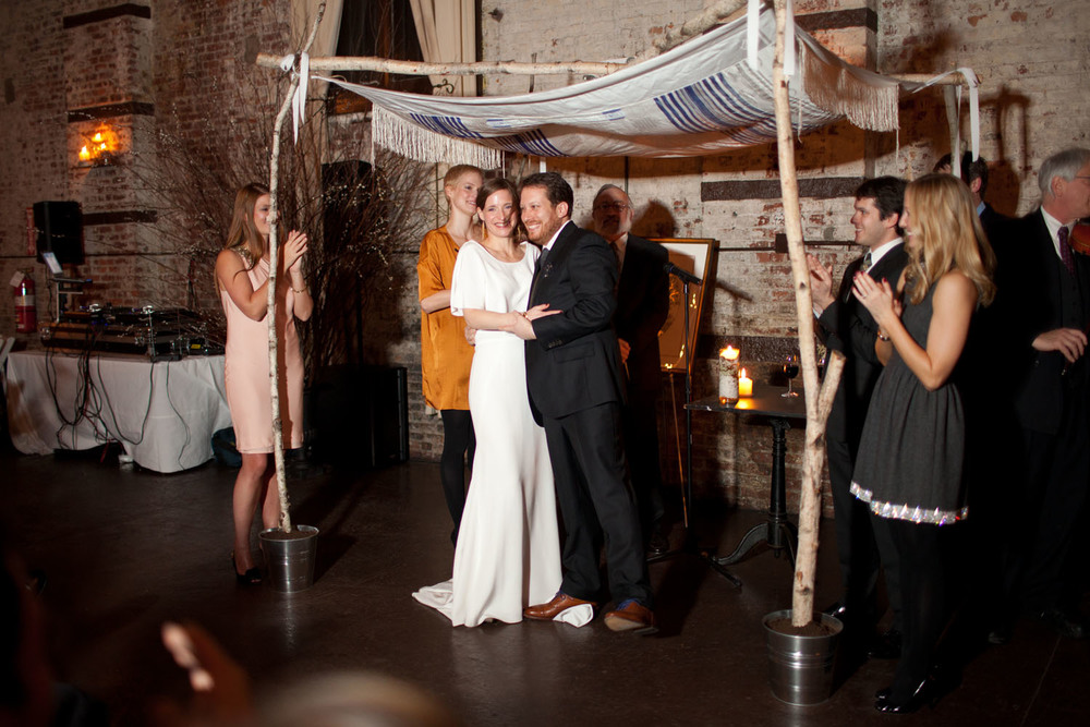 Under the huppah at this Brooklyn real Winifred Bean wedding featuring vintage-inspired Audrey dress