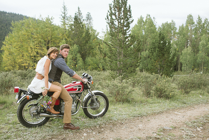 Couple married in Colorado, view of chiffon v-neck Winifred Bean vintage-inspired Daisy dress as they ride off on motorcycle