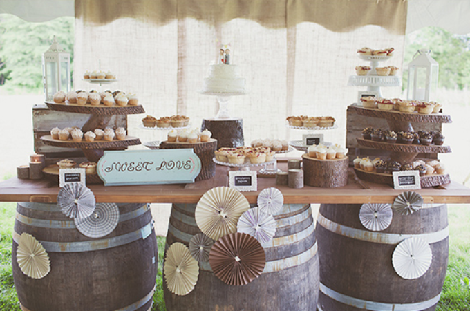 sweets table using wine barrels at vineyard themed wedding