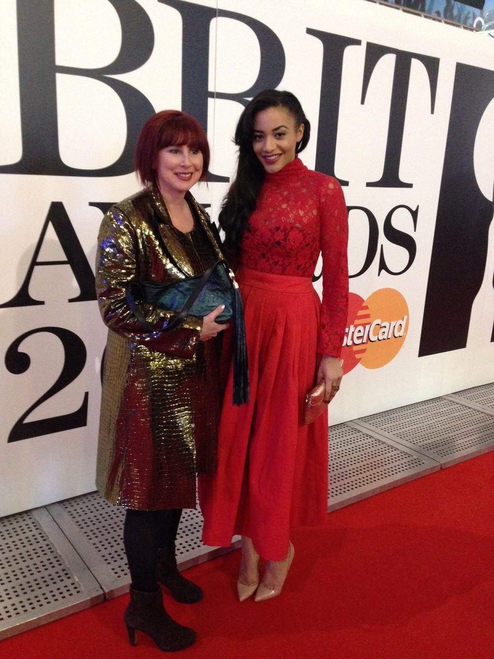 Amal Fashanu pictured on the Red Carpet with designer Liz Cox