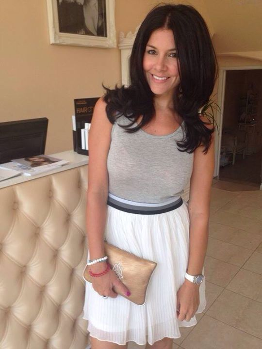 Imogen looking radiant after Latifa Durbin worked her magic.  Pictured in the salon with a Hamsa purse (sold in the salon)
