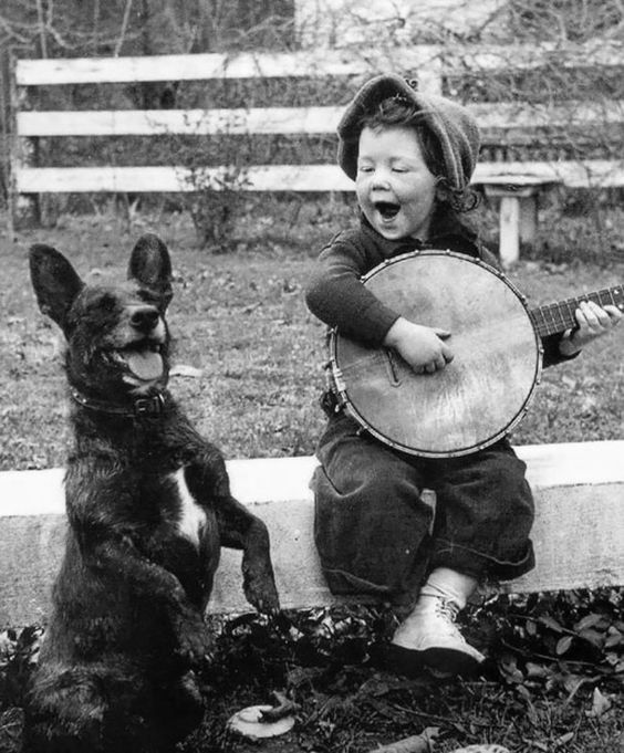 Dog and girl with banjo